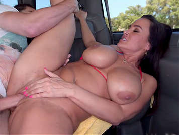 Sexy milf with big tits fucked in a van with her tits full of cum