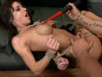 Extreme sex with a brunette tied with ropes