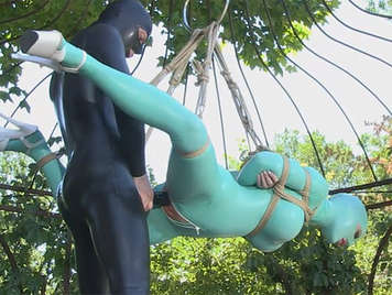 Extreme sex hanging from a rope wearing latex fucked in her juicy pussy