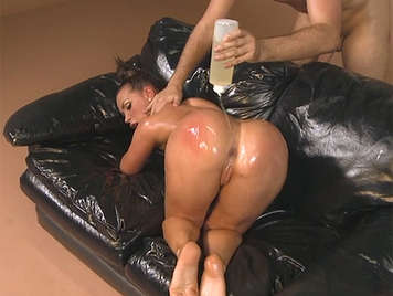 Kim Kardashian disguised as a fucked in the ass covered in body oil