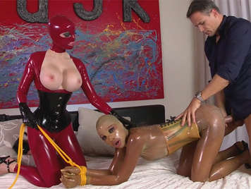 Extreme anal sex with two sluts dressed in latex outfits that leave the ass fuck