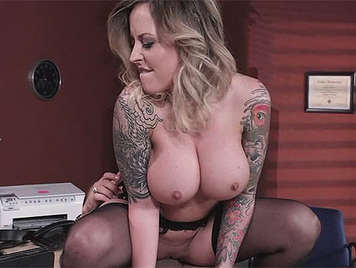 Busty secretary with tattooed arms and very accommodating with tits covered with sperm