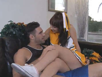 Brunette cheerleader with pompoms sucking a cock and fucked on the couch