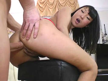 Asian brunette enjoys anal sex