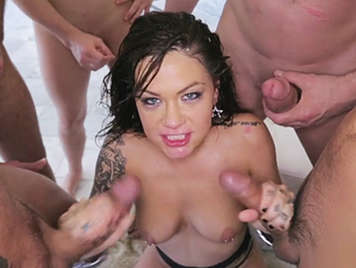 Brunette slut swallows cocks down her throat in this bukkake