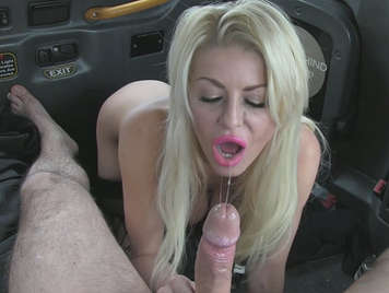 Busty blonde and very greedy, sucking cock and fucking in a taxi