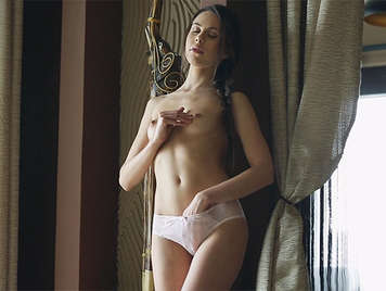 Masturbating with panties tucked under her hand, she squirts, and putting his fingers in her sweet pussy enjoying the pleasure of a sweet and prolonged orgasm