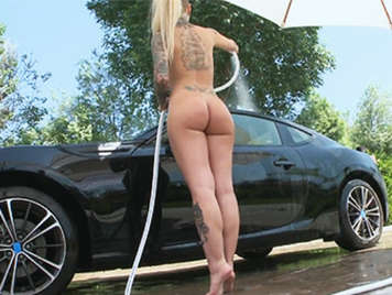 Stunning 22 year old slut  with tattoos and a perfect ass washing the car in a very sexy way