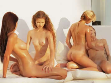 Foursome among lesbian girlfriends with natural tits covered in oil