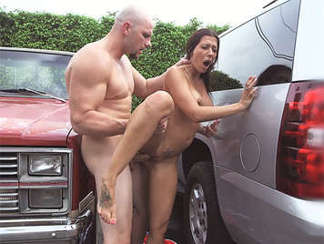 Fucking a sexy busty milf in a public parking filling her face and tits with a spectacular cumshot