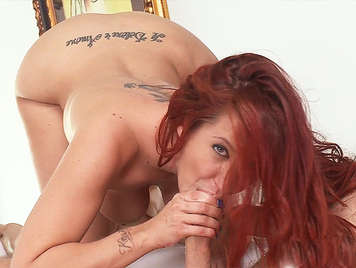 Spectacular redhead doing an incredible blowjob fucked in the ass cum on her mouth
