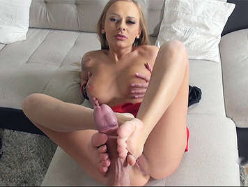 Busty blonde makes a straw with a cock between feet and she sucks her fingers covered of cum