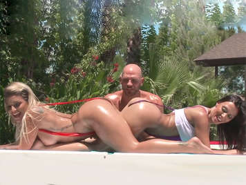 Threesome with two sluts in tiny bikinis, fucking wildly in the pool