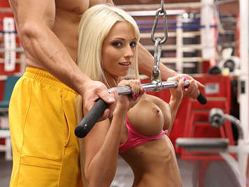 In the gym fucking a spectacular blonde with big tits and hard of silicone
