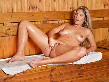Horny busty blonde masturbates in a sauna, until reach out a wave of intense and wet orgasms