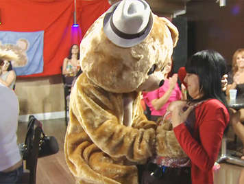 Bachelorette party with a giant dancing bear with a big cock that flows in the mouths of a few invited