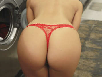 Beautiful girl in thong playing with her ass full of soap in a laundry